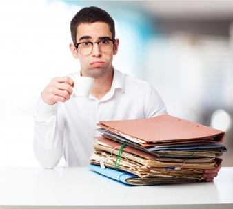 man-with-sad-face-with-folders-and-a-cup-of-coffee_1187-3117